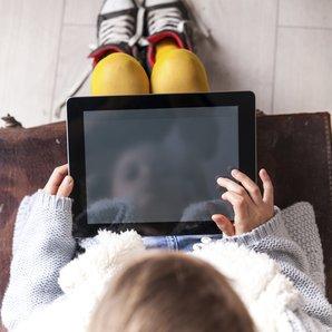 little girl on iPad stock image