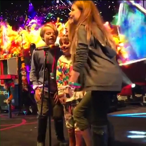 Simon Pegg's Daughter Matilda Sings With Coldplay