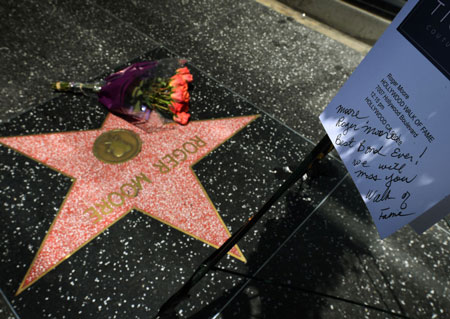 Roger Moore tribute on star on The Hollywood Walk
